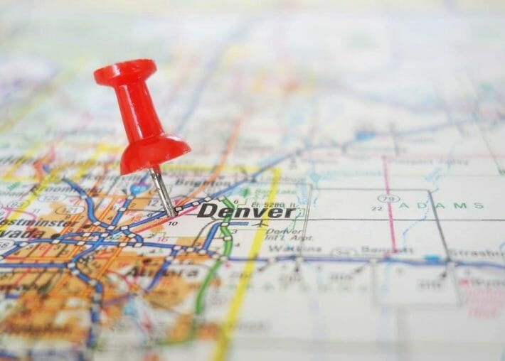 Closeup of a map of Denver, CO with a red pushpin