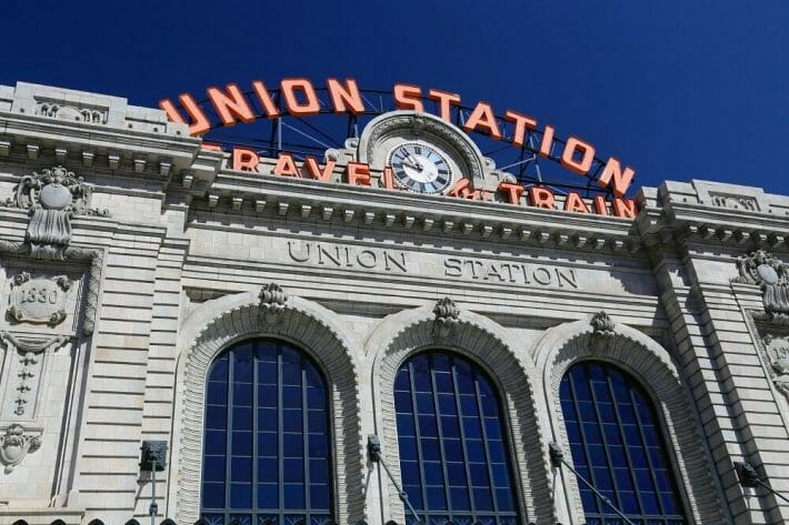 A closeup view of the sign at the historic union train station building in Denver