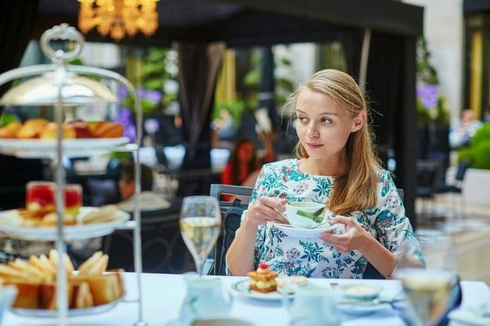A young blonde woman enjoying afternoon tea during her denver bachelorette party