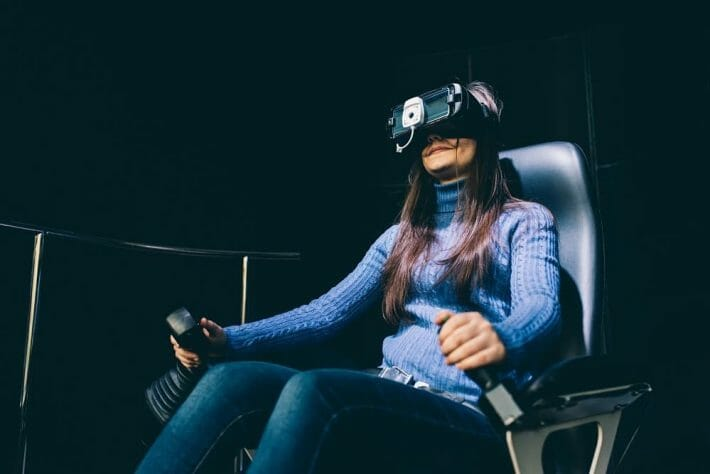 Young woman sitting in a virtual reality gaming chair
