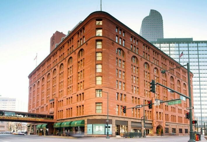 Corner view of the Brown Palace Hotel & Spa in Denver; brownish red brick exterior