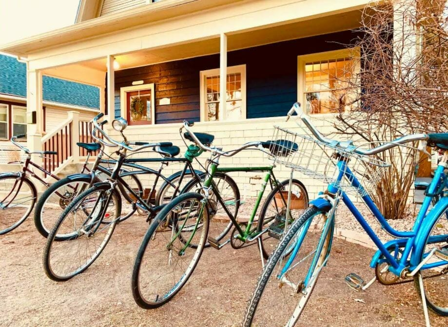 five cruiser bikes sitting in front of an Airbnb Grand Junction