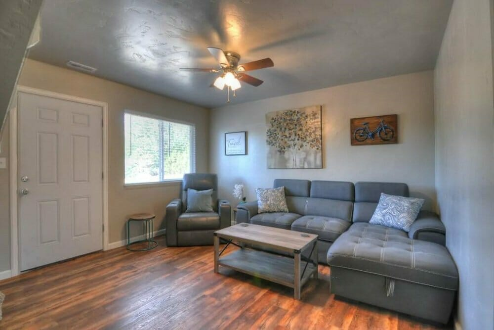 warm hardwood floors and gray furniture in the living room