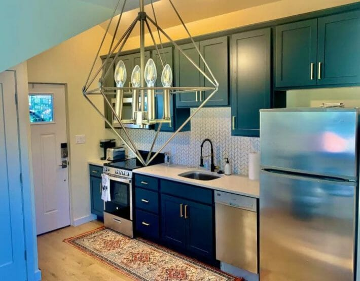 small but modern kitchen with beautiful chandelier