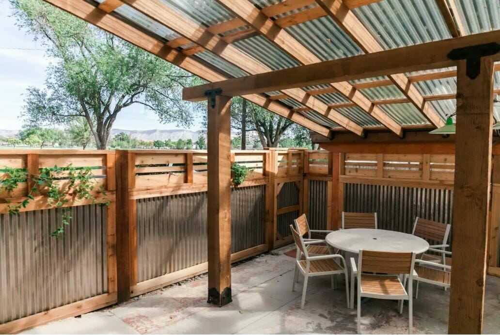 back patio space with seating and beautiful wood fencing/roofing