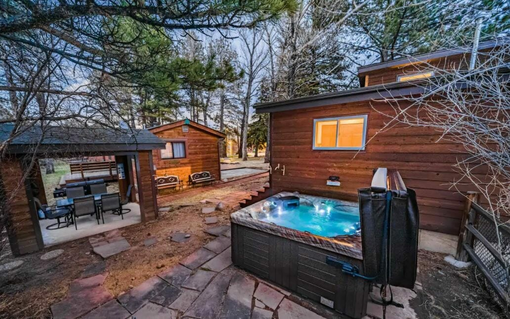 Exterior view of Estes Park, Colorado cabin with a hot tub in the foreground