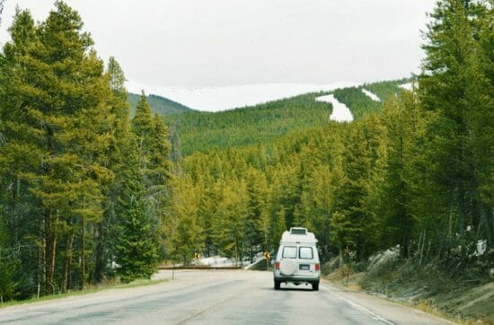 day trips from Denver - a van drives down a tree lined highway