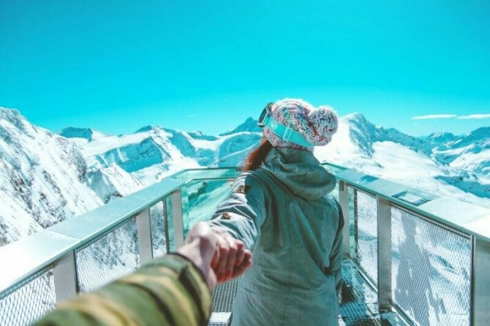 romantic-getaways-in-colorado_couple-in-the-snow-holding-hands.jpg?strip=all&lossy=1&resize=710%2C473&ssl=1