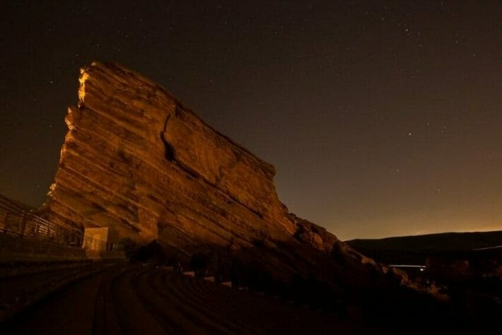 Large red rocks formation at night, stars in the sky - perfect for stargazing Denver