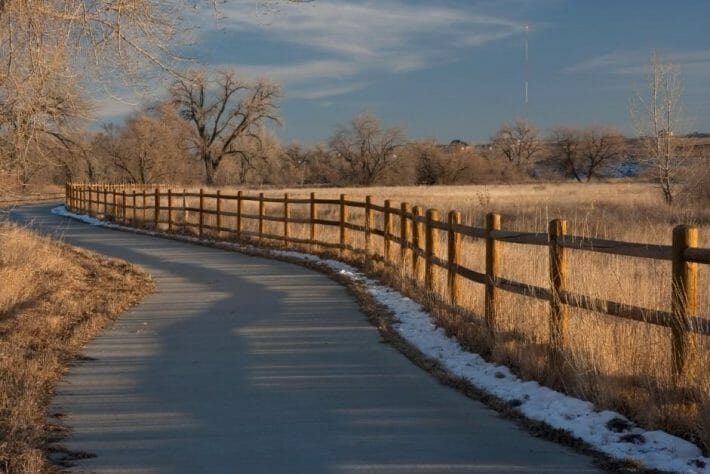 Denver bike trails are well maintained like this paved bike path through a nature preserve